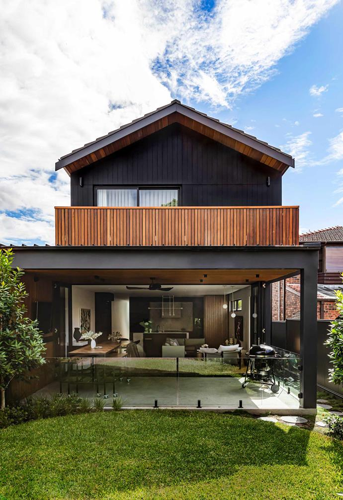 "**Terrace** Bi-fold doors and [automatic awnings](https://www.homestolove.com.au/outdoor-awnings-and-blinds-3962|target=""_blank"") have created a semi-weatherproof extension of the family's [living room](https://www.homestolove.com.au/modern-living-room-ideas-18535