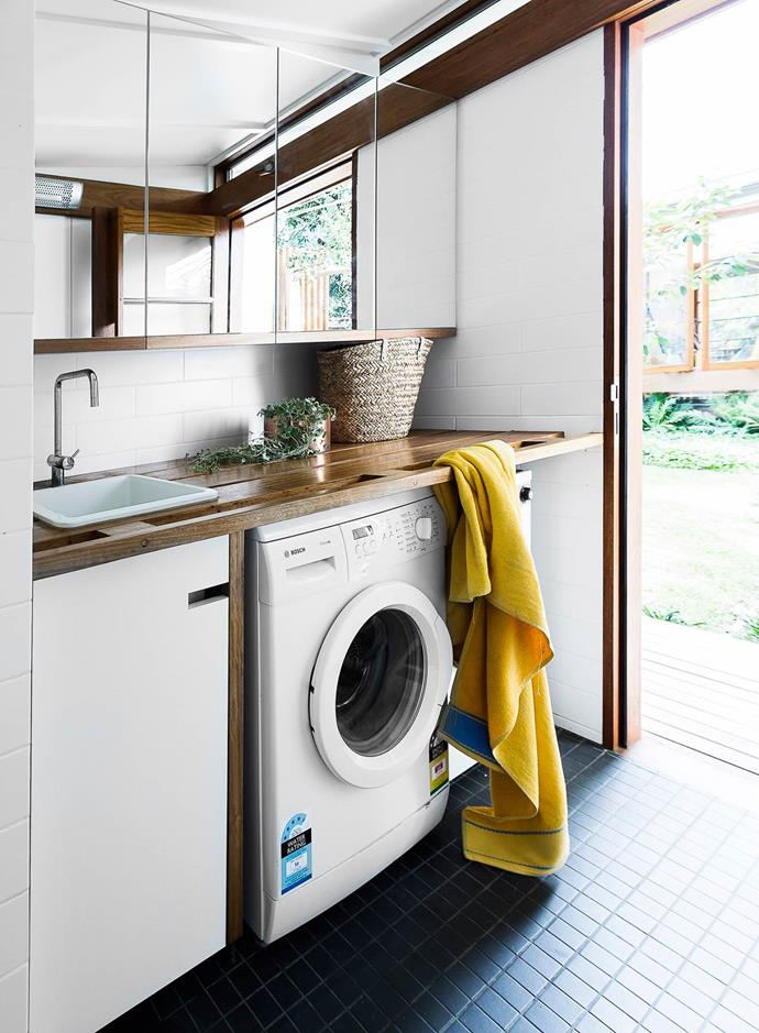 Located in a self-contained studio in the garden of a northern Sydney home, this laundry is designed for easy after-pool access. The mirrored doors to the cupboard give it a more sophisticated, un-unitarian feel.