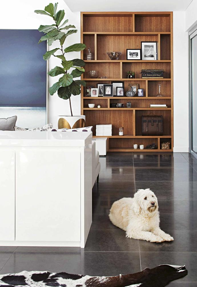 "If you walk into your living room and see the back of your sofa fix this [styling faux pas](https://www.homestolove.com.au/7-interior-styling-no-nos-15168|target=""_blank"") and gain more storage by placing a sideboard behind it. The contemporary, sleek white option in this [contemporary Noosa home](https://www.homestolove.com.au/contemporary-house-noosa-21465