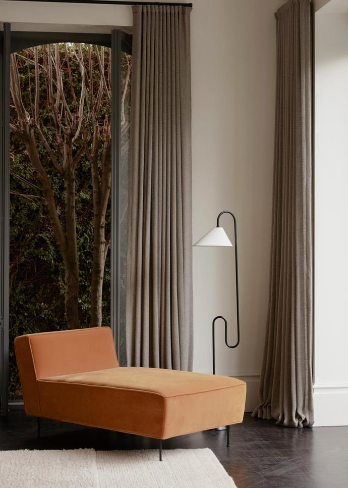 The sculpture is a custom wardrobe designed by Fiona Lynch hand-finished in aluminium, wax crayon and solid maple. The sitting room features a Gubi 'Modern Line' chaise from Criteria. Bella Design rug from Halcyon Lake. ClassiC on 'Roattino' lamp from Anibou.