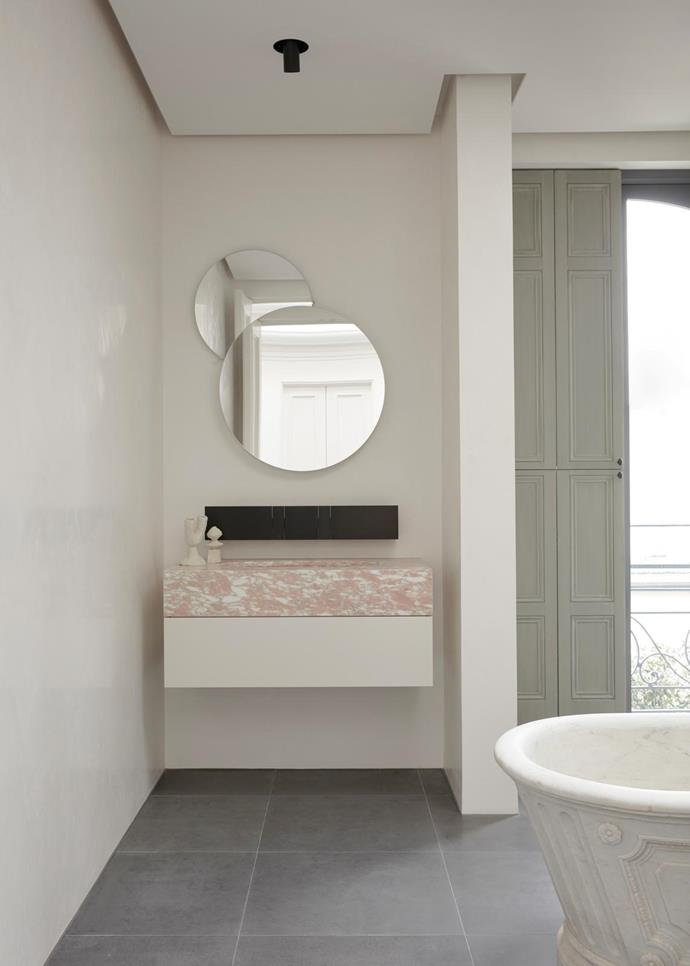 Agape 'Eclipse' mirror and 'Sen' wall-mounted tap from Artedomus. Mr Kitly ceramics.
