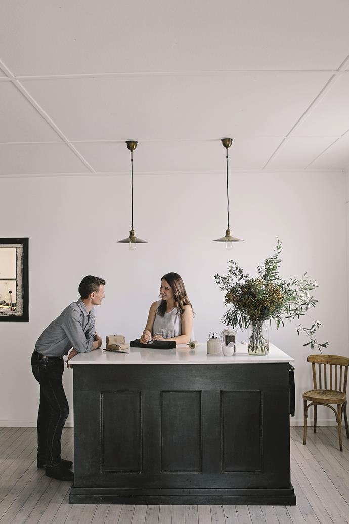 Bede and Jemima Aldridge at the shop counter, which was designed by the couple and made by Bede. The countertop is a slab of Smartstone 'Carrara'.