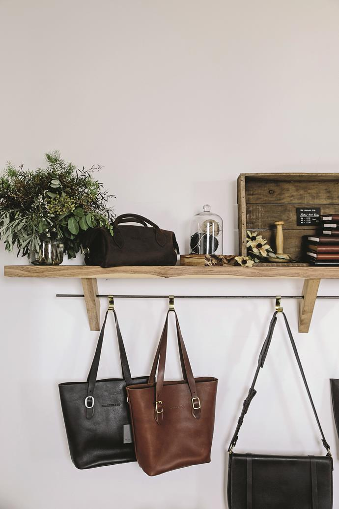 The 'Classic Tote' bags in Cocoa and Caramel hang alongside other Saddler and Co creations.