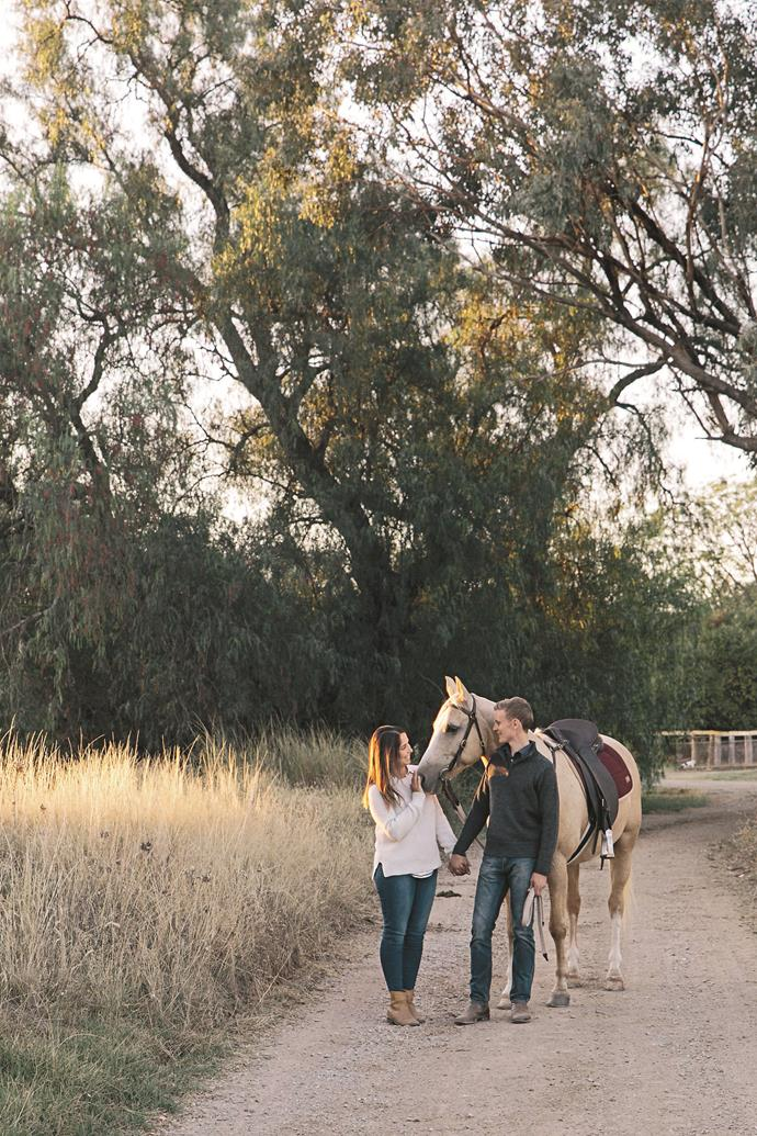 Bede spent years riding horses. Here, he and Jemima try a custom-made saddle on a horse at Hugh and Mardi Taylor's 'Willunga' property.