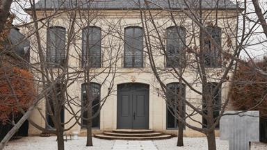 A chateau-style home with a minimalist interior