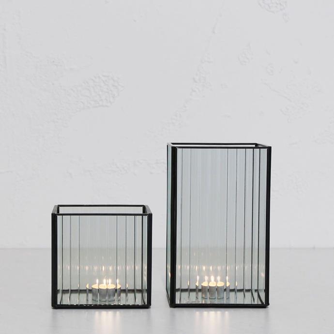 "Ridged black framed hurricane lantern bundle, medium + large, $64.98, [Living by Design](https://livingbydesign.net.au/products/ridged-black-framed-hurricane-lantern-bundle-1-medium-1-large-lantern?variant=31922672762993&currency=AUD&gclid=Cj0KCQjw-uH6BRDQARIsAI3I-UfMTA2PoT8Z5FhI5Ju48XEzobyB91Doox6htEhax_ECYgahaqXnyCcaAhV0EALw_wcB|target=""_blank""|rel=""nofollow"")"