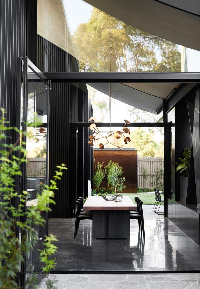 "In this [strikingly modern home](https://www.homestolove.com.au/strikingly-modern-home-that-embraces-contrasting-design-elements-20927|target=""_blank"") the architectural features are paired with pared-back furnishings to emphasise the sense of space."