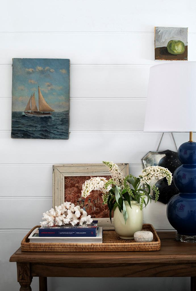 """Brent's room features a sailboat painting found on 1stdibs. """"I think I might have been missing the ocean a little bit,"""" he says. The lamp is from Pigott's Store."""