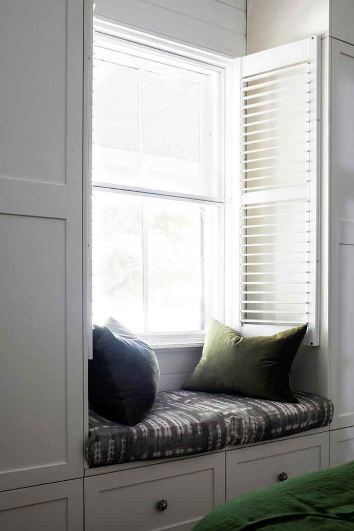 A window seat in the bedroom provides the perfect place to sit a read.