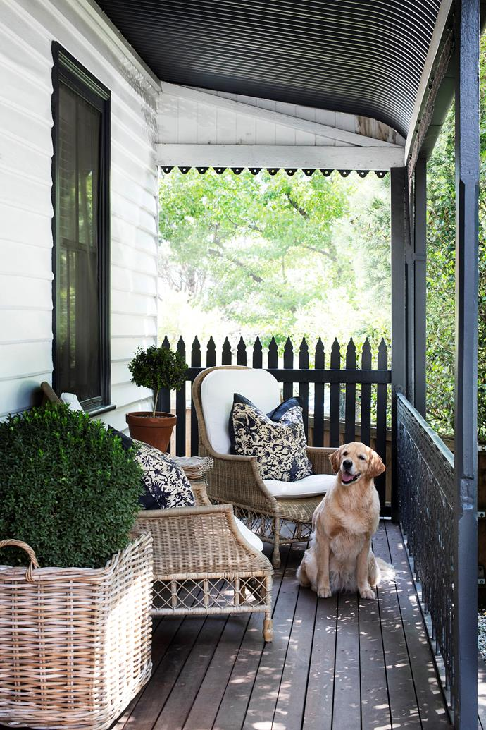 The attractive verandah welcomes visitors to Brent and Dan's home – as does Abby the golden retriever.