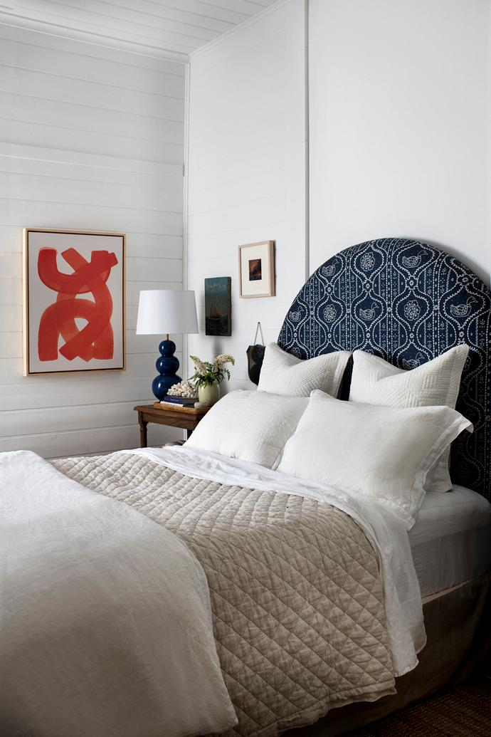 Brent's bedhead is upholstered in Anna Spiro Textiles fabric, and the abstract painting is by Louise Tuckwell.