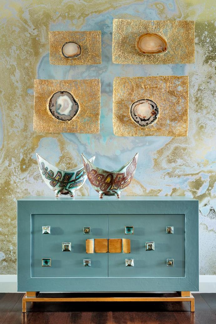 In a corner of the master bedroom a pair of 1970s Accolay vases sit atop a leather-clad 'Cleopatra' commode designed by Christian. Four vintage wall lights by French designer Jacque d'Aubres in gilded brass filigree and agate from Editeur.