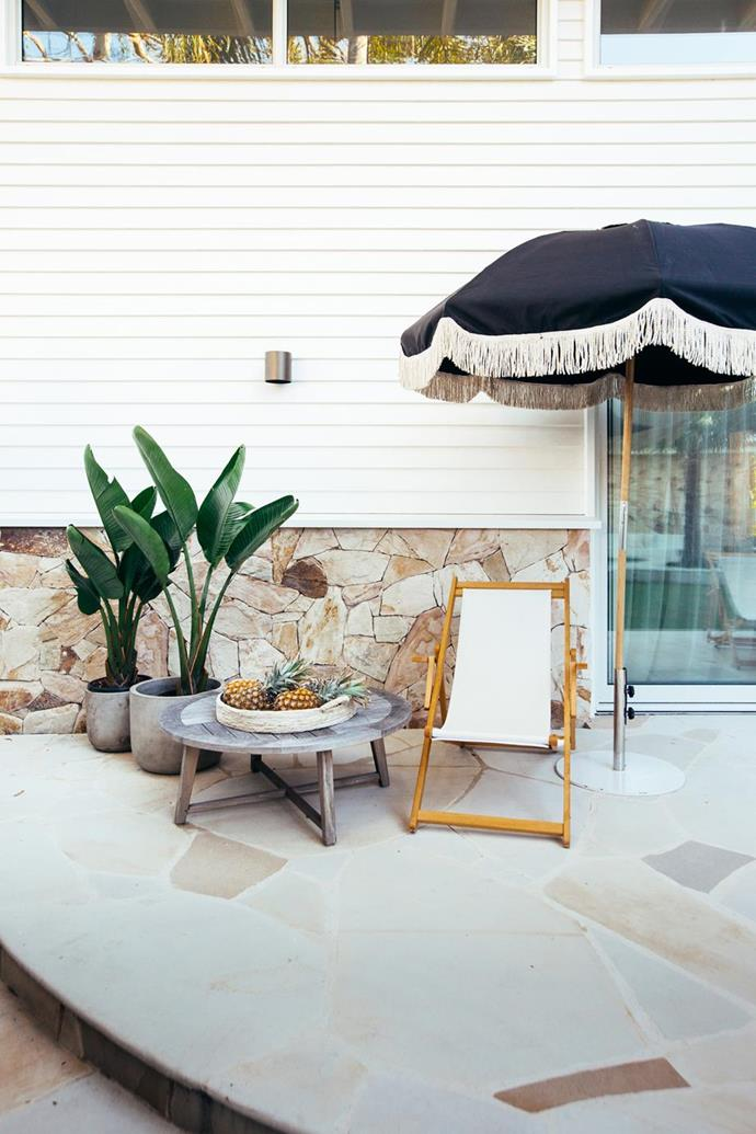 "Curved concrete walls, crazy sandstone paving and feature walls, palm trees and a sparkling blue pool all help to achieve a Mediterranean look in [Kyal and Kara's coastal garden and pool](https://www.homestolove.com.au/mediterranean-coastal-garden-21467|target=""_blank"")."