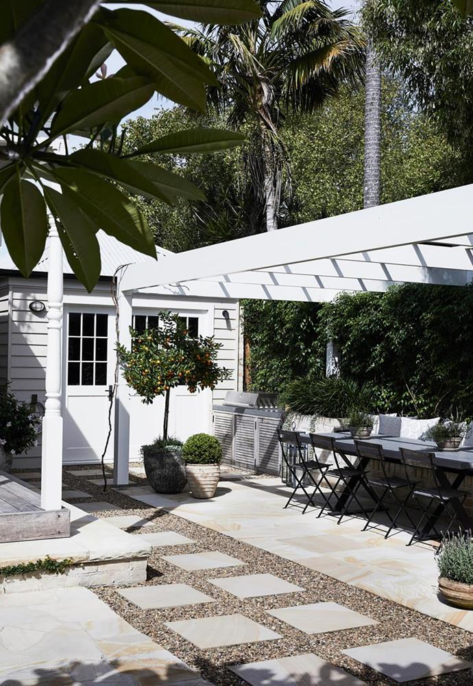 "In the garden of this [charming weatherboard cottage in Berry](https://www.homestolove.com.au/charming-weatherboard-cottage-in-berry-20329|target=""_blank"") a custom barbeque enclosure has been divided from the rest of the courtyard with a wooden canopy and sandstone pavers."