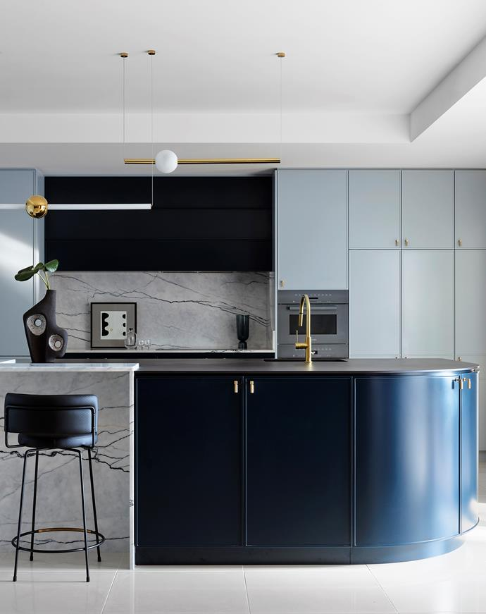 "Set in a transitional space between the entry and open-plan living zones of a grand home, this kitchen called for graceful curves and an ethereal palette, which Lynne Bradley delivered with aplomb. ""The use of luxury materials, sculptural forms, newly released ovens, beautiful lighting and ample storage punctuated with brass hardware combines to create a uniquely designed kitchen tailored perfectly to the owners and their home."""