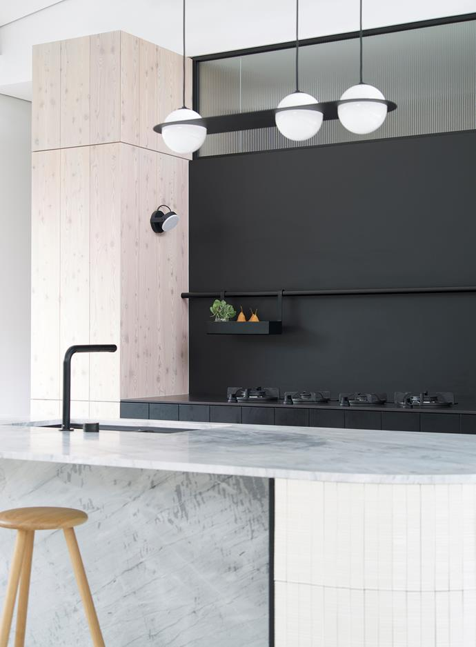 "While a certain drama unfolds in this crisply defined black and white kitchen, it plays out as a harmonious whole thanks to the skilled direction of designer Carole Whiting. ""The client briefed us to design a clean and modern kitchen with a fresh palette."""