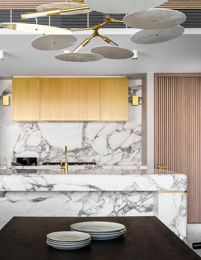 "Ultra-luxe bespoke finishes characterise this newly built Bondi Beach apartment with interiors by designer Bianca Fraser of The Unlisted Collective that enshrine contemporary sophistication. ""High-quality materials were used, with Arabescato marble for benchtops and terrazzo flooring continued throughout the kitchen, walk-in pantry and adjacent living spaces. Golden accents were introduced through overhead joinery, hardware and shadowlines to the curved island and door hardware."""