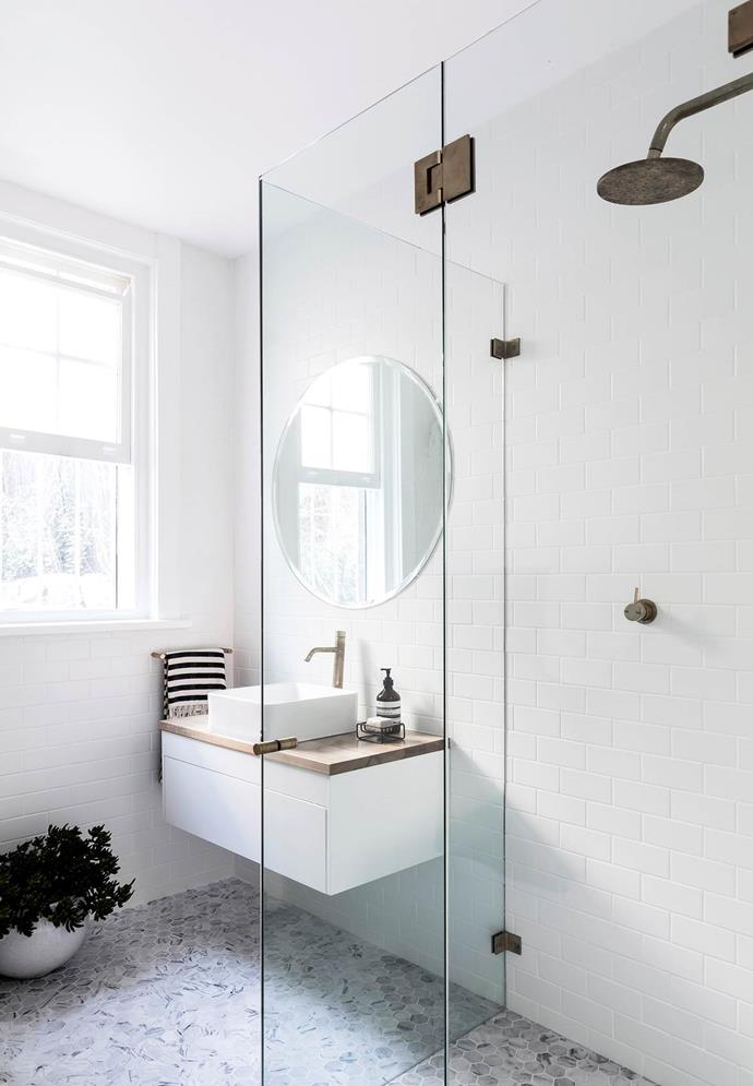 **Opt for a wall-mounted vanity.** Bathrooms are commonly rooms where space is an absolute premium and a suspended vanity frees up the floor. In this instance, constructing a mid-level wall to hang it off also creates a handy shelf, another excellent space saver!