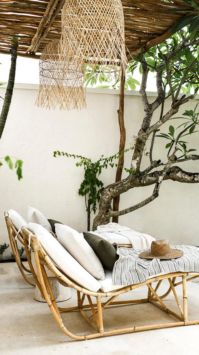"The cane sun loungers are the perfect place to relax after a swim at the sustainable [Bali home of the Yoli & Otis founder](https://www.homestolove.com.au/yoli-and-otis-bali-home-19838|target=""_blank"")."