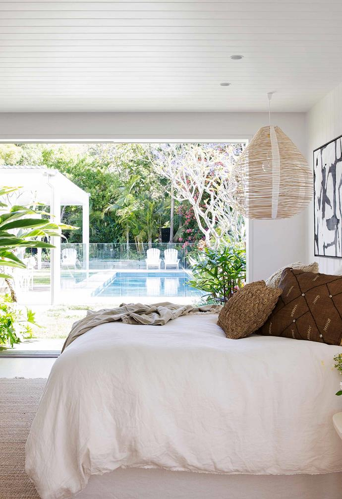 """A sliding door in the bedroom of this [fibro cottage in Avalon](https://www.homestolove.com.au/fibro-cottage-avalon-20548