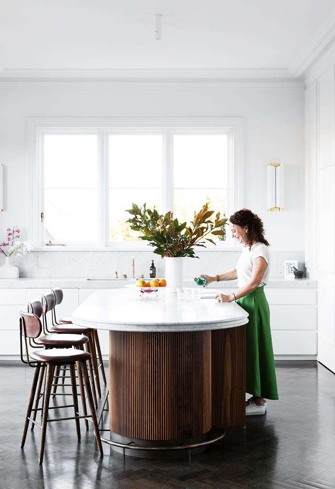 """I contemplated hanging a linear [pendant light over the kitchen](https://www.homestolove.com.au/kitchen-pendant-lights-6391