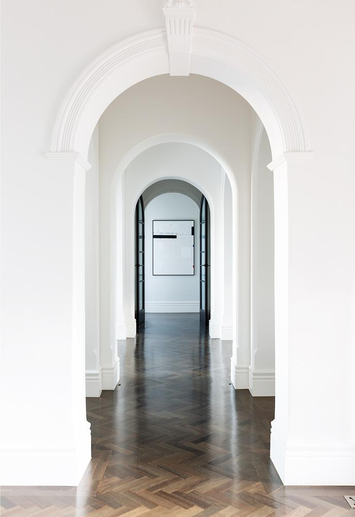 The original arched hallway entrance to the rear of the home had been boxed in by the previous owners. Restoring the arch was one of the initial design decisions made by MJ, designer Viv and project architect Imogene Potter. Functionally, the move allowed a lot more light to stream into the space, but it also provided a 'motif' for the rest of the interiors.