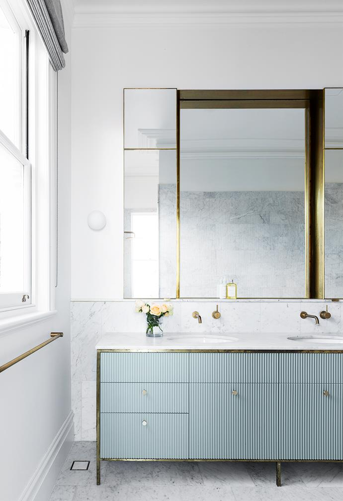 "Andrew and MJ's [glamorous ensuite](https://www.homestolove.com.au/luxurious-ensuite-bathrooms-21037|target=""_blank"") continues the elegance of their bedroom, with Carrara marble floor and Salvatori wall tiles, a Parisi bath and stunning brass detailing in the cabinetry, [towel rail](https://www.homestolove.com.au/best-bathroom-towel-racks-12944