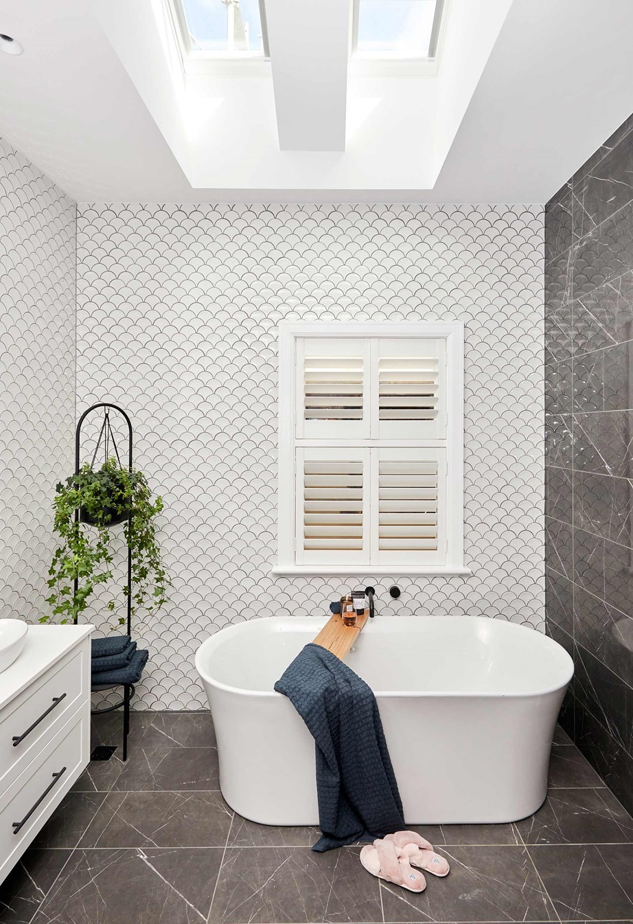 "**Week 4, Master Ensuite** The judges agreed that the combination of the curve of the fishscale tiles and that of the bathtub added a ""beautiful delicate subtlety"" that contrasted well with the hard lines of the black marble tiles in Daniel and Jade's master ensuite."