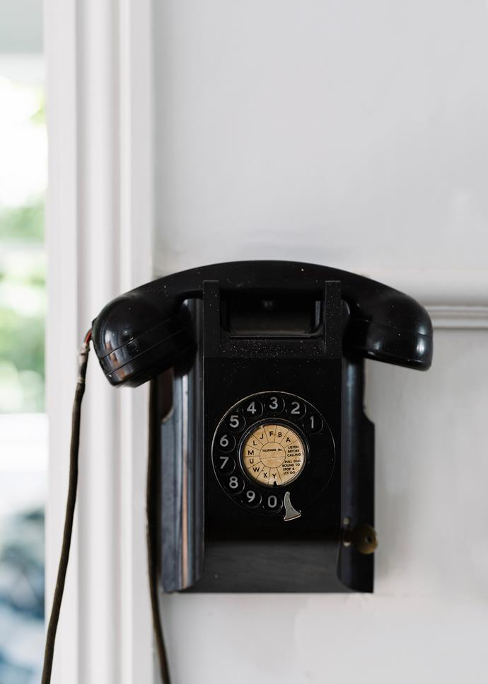 A vintage bakelite phone in the hallway.