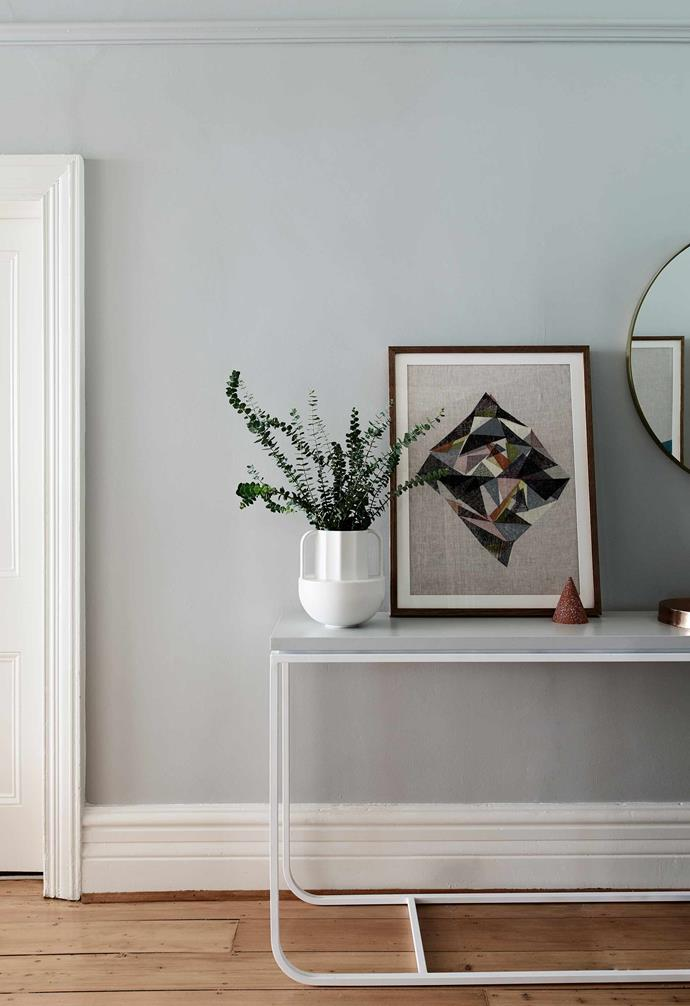 """**Hallway** As this corridor links the Edwardian section of the house with the lighter extension at the back, Julia didn't want to go too dark on the hall walls, which are painted a soft grey called [Dulux](https://www.dulux.com.au/ target=""""_blank"""" rel=""""nofollow"""") Tranquil Retreat. Console table, [Grazia & Co](https://graziaandco.com.au/ target=""""_blank"""" rel=""""nofollow"""")."""