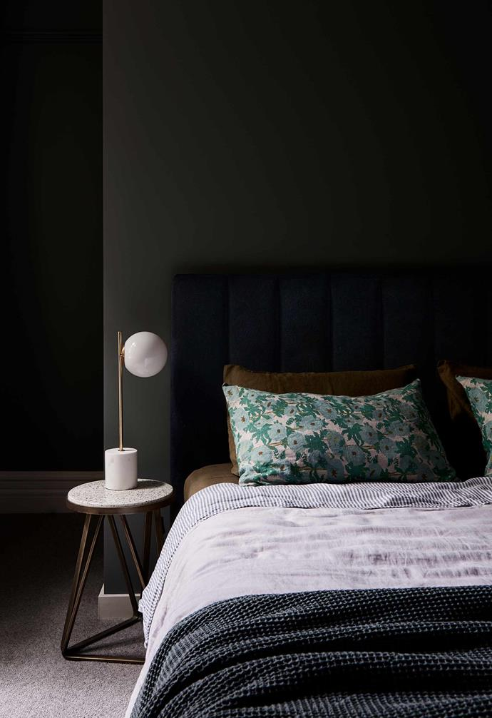 """**Main bedroom** Walls in [Dulux](https://www.dulux.com.au/ target=""""_blank"""" rel=""""nofollow"""") Hildegard continue the moodier palette in here. """"It feels so cosy and relaxing,"""" says Julia, adding that the striking Flos 'IC' pendant is """"definitely an investment piece that we'll have forever"""". The armchair is a reupholstered eBay find."""