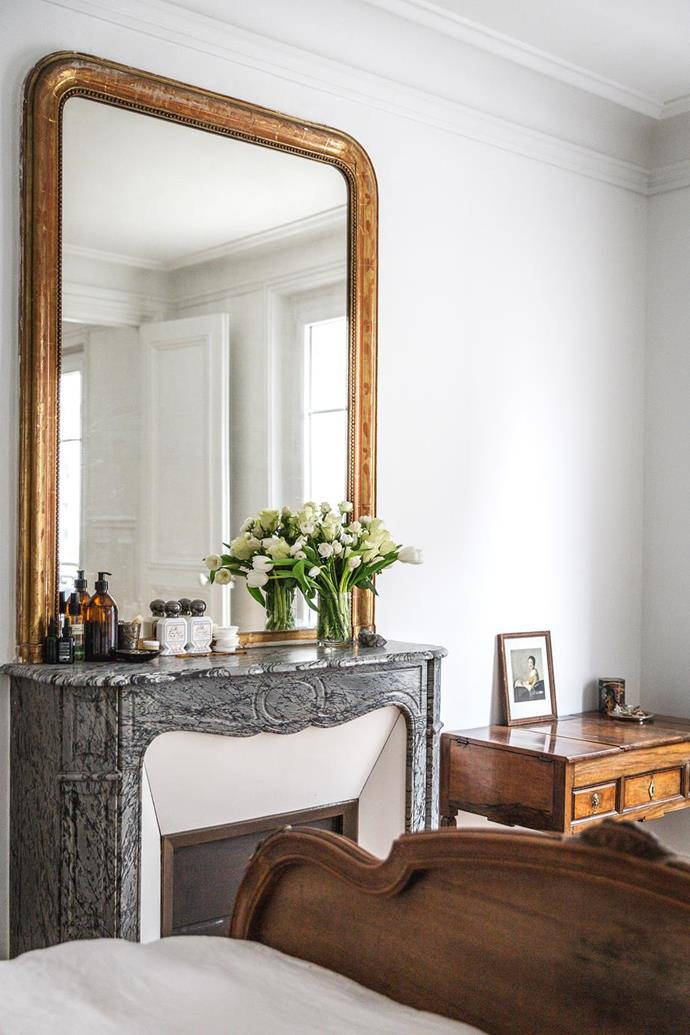 """The master bedroom in this [pastry chef's charming Parisian apartment](https://www.homestolove.com.au/classic-parisian-apartment-21721