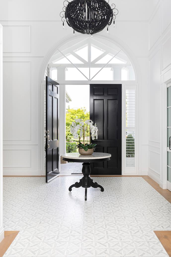 """""""Arches were a key feature,"""" says Mieke of the spacious doorways opening through onto balconies. The most striking is the arched clerestory window above the front door, which floods the entrance with [natural light](https://www.homestolove.com.au/how-to-increase-natural-light-in-home-15836 target=""""_blank"""") and draws the eye upwards, to where a Klaylife pendant hangs like a piece of art."""