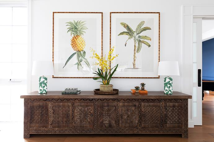 Rather than set a deadline to furnish the house, Mieke instead spent several years gradually sourcing the perfect pieces to add character and interest in each space. A treasured find is a 'Jacques' 7 door Wisteria Design timber sideboard which, teamed with Boyd Blue prints and a palm lamp from Beacon Lighting, adds a tropical plantation feel.