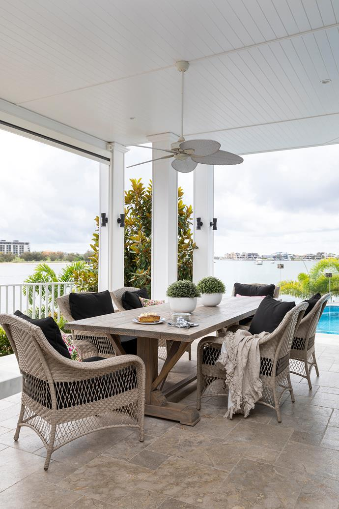 Outside, a Hamptons-style table from Mrs Blanchett's is teamed with Domayne chairs.