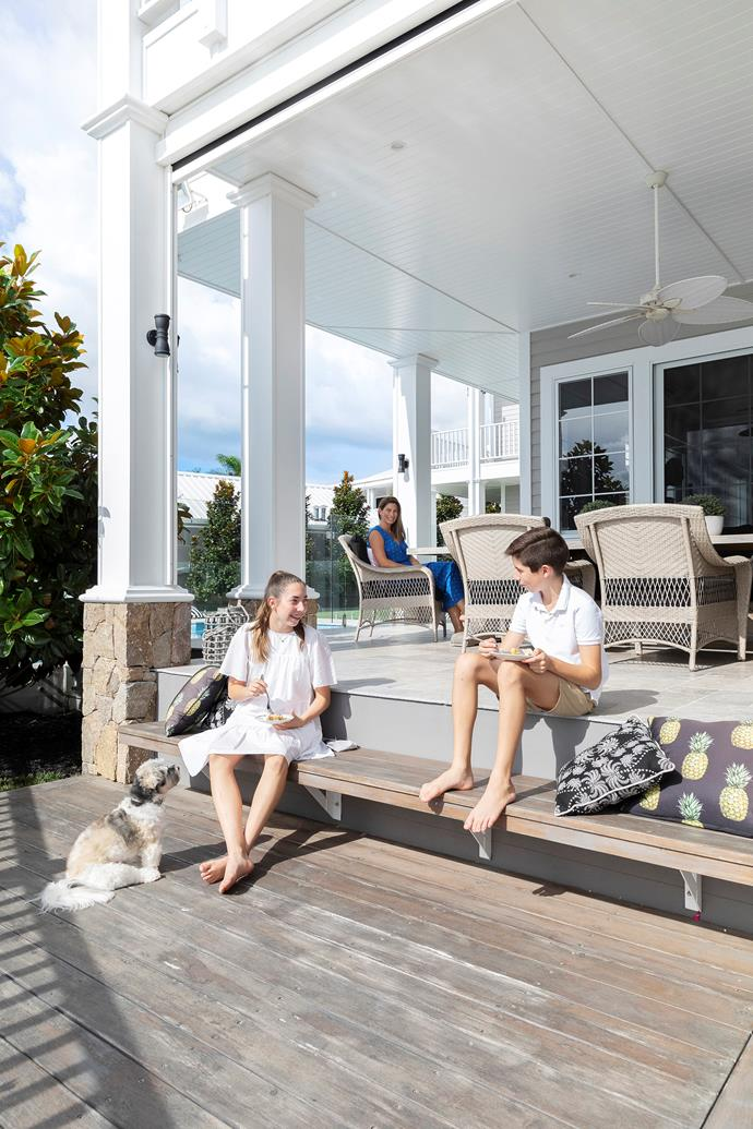 The Hamptons feel extends outside, where the walls and ceiling are clad in James Hardie Linea weatherboards.