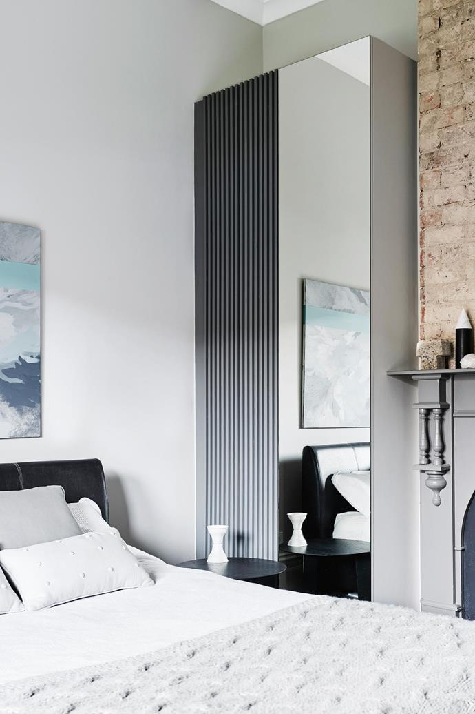 """A mirrored wardrobe in this [dreamy bedroom](https://www.homestolove.com.au/calming-bedroom-decor-17095