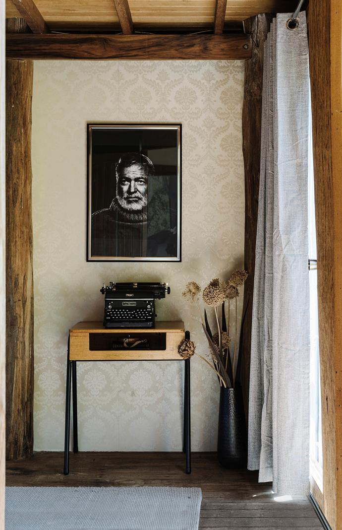 A vintage typewriter, writing desk and portrait are a nod to the couple's décor inspiration, Ernest Hemingway.