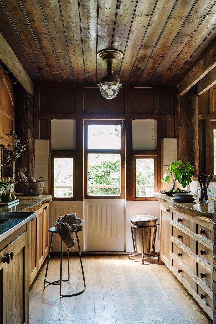 The kitchen is a clever mix of train carriage panels and sturdy timber benchtops made from a cypress pine that was milled locally.