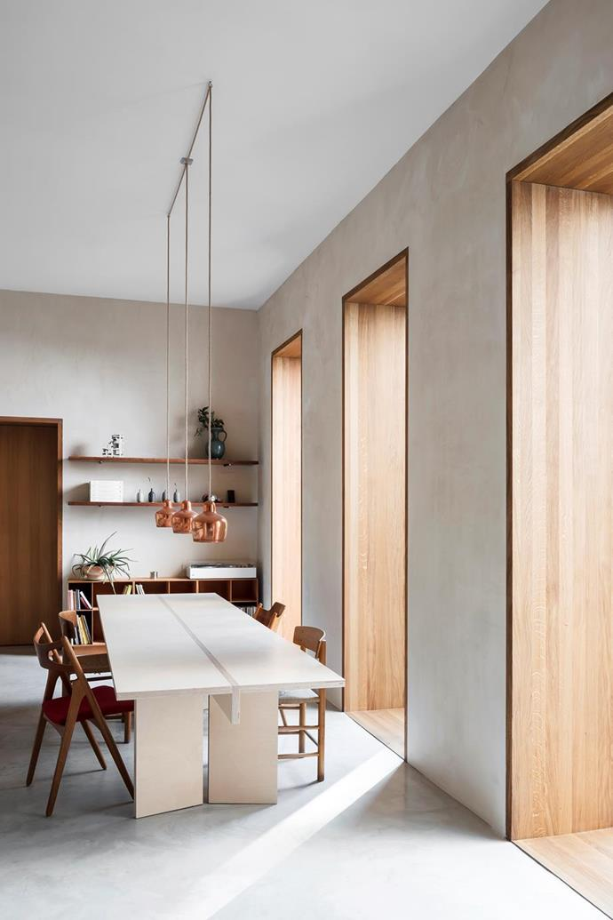 "The minimalist table in the open-plan dining room of this [neutral, textural home in Berlin](https://www.homestolove.com.au/neutral-home-19204|target=""_blank"") was crafted from leftover wood from the construction."