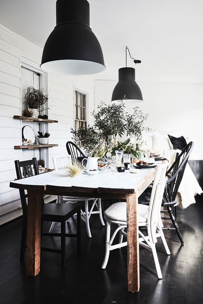"The dining table in this [Kangaroo Valley cottage](https://www.homestolove.com.au/the-cottage-kangaroo-valley-19551|target=""_blank"") was made using timber from a friend's property. It's just the right size for having lots of friends over. ""We love to entertain,"" explained Lisa, the owner.""It's a special thing to host people and make them feel loved, relaxed and welcome."" Mismatched chairs add to its charm."