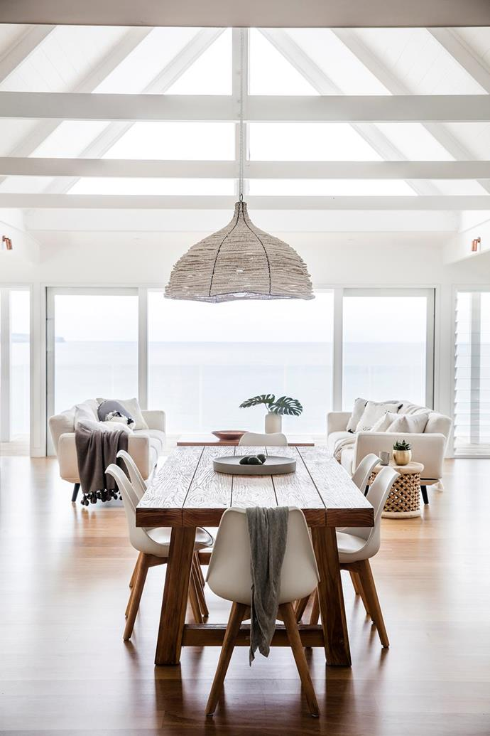 "A rectangular timber dining table and simple white chairs creates a relaxed feel and allows diners to take advantage of the spectacular views from this modern, [light-filled beach house in Sydney's Palm Beach](https://www.homestolove.com.au/beach-house-renovation-19763|target=""_blank"")."