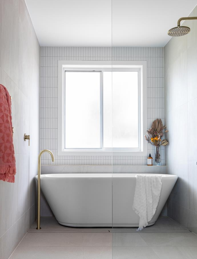 """When Chris and Christal Fysentzou, owners of construction firm Zou Build, bought this fixer upper in Brisbane they had a clear vision for its main bathroom: """"I wanted it to have a calm, sumptuous feel but it needed some reconfiguring to make the layout work better,"""" says Christal. Plumbing was shifted to create wet and dry zones in the 3x1.8-metre main bathroom."""