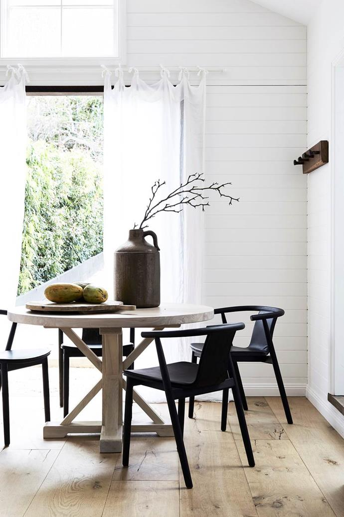 "A small round table was the perfect solution for the dining nook in this [Byron Bay beach house](https://www.homestolove.com.au/beach-house-decorating-ideas-20822|target=""_blank"")."