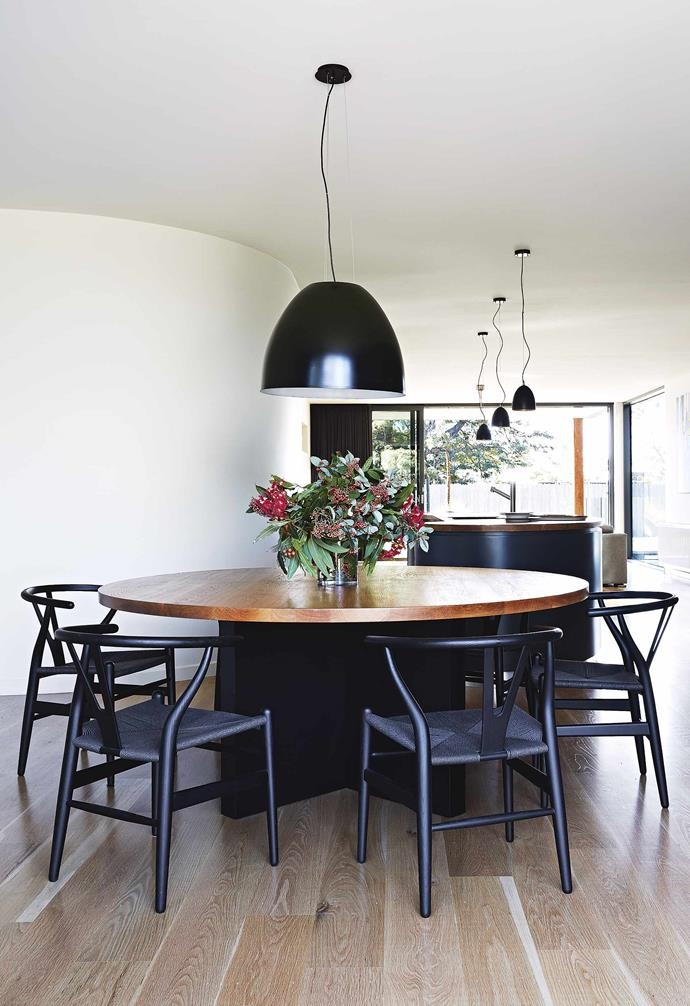 """**David, you have a penchant for unique design. How would you describe your aesthetic?** I'm drawn to [high quality and durable homes](https://www.homestolove.com.au/architectural-homes-19696 target=""""_blank"""") finished with a critical eye for detail, but at the same time keeping the design and materials simple and natural.<br><br>**Dining** The [round dining table](https://www.homestolove.com.au/round-dining-room-table-design-ideas-19998 target=""""_blank"""") and sculptural dining chairs echo the curves of the kitchen island bench."""