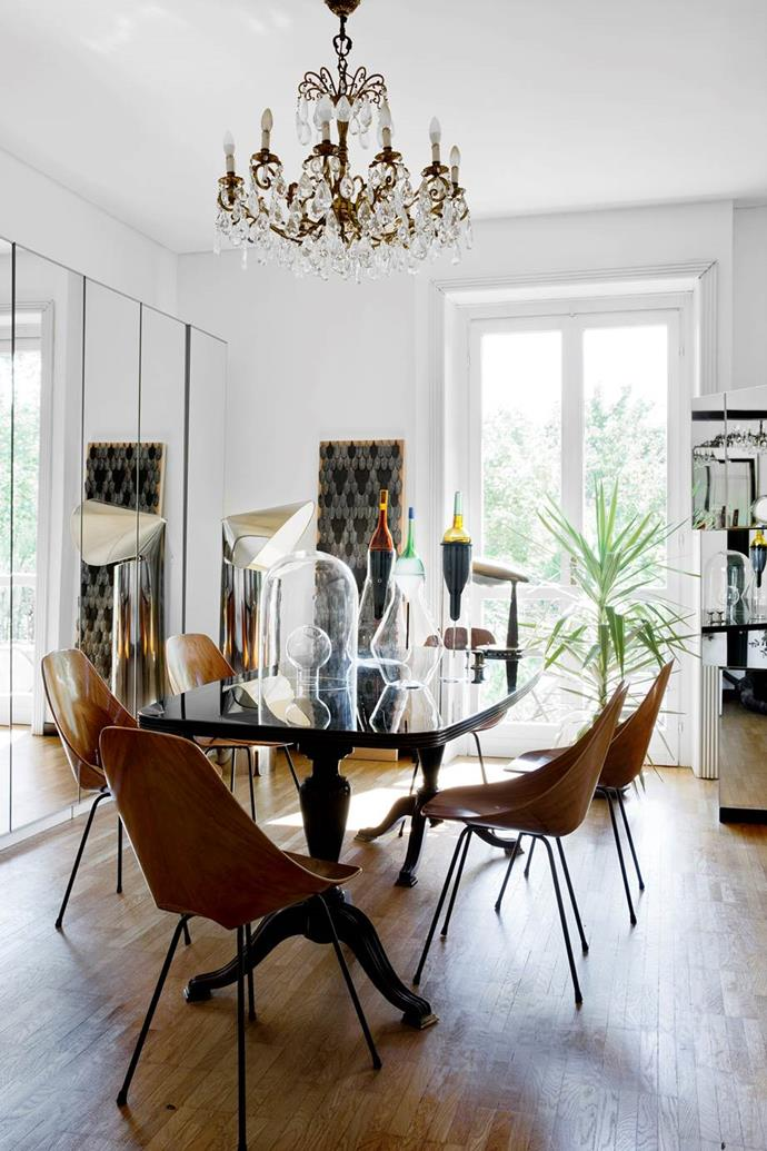 "The dining room in [Italian-born designer Cristina Celestino's apartment](https://www.homestolove.com.au/modern-eclectic-decorating-12728|target=""_blank"") is a lesson in working with various shapes and materials. Cristina inherited the elegant old dining table when she bought the apartment, and has paired it with wooden chairs from the 1950s."