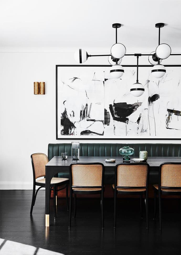 "The owner of this [modern Art Deco home](https://www.homestolove.com.au/modern-art-deco-home-20290|target=""_blank"") enlisted furniture maker Tim Noone to create her Curatorial dining table, with the custom banquette and Thonet 'Hoffmann' chairs providing seating for 10, in the home's signature emerald colour."