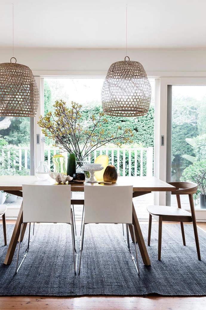"The table and wooden curve chairs in this dining space look out over the garden of this [fashion influencer's sunny Sydney home](https://www.homestolove.com.au/tash-seftons-stylish-sydney-home-6549|target=""_blank""), are ""a beautiful design and so comfortable"" according to the owner, from Clickon Furniture. They sit on a rug from Armadillo & Co."