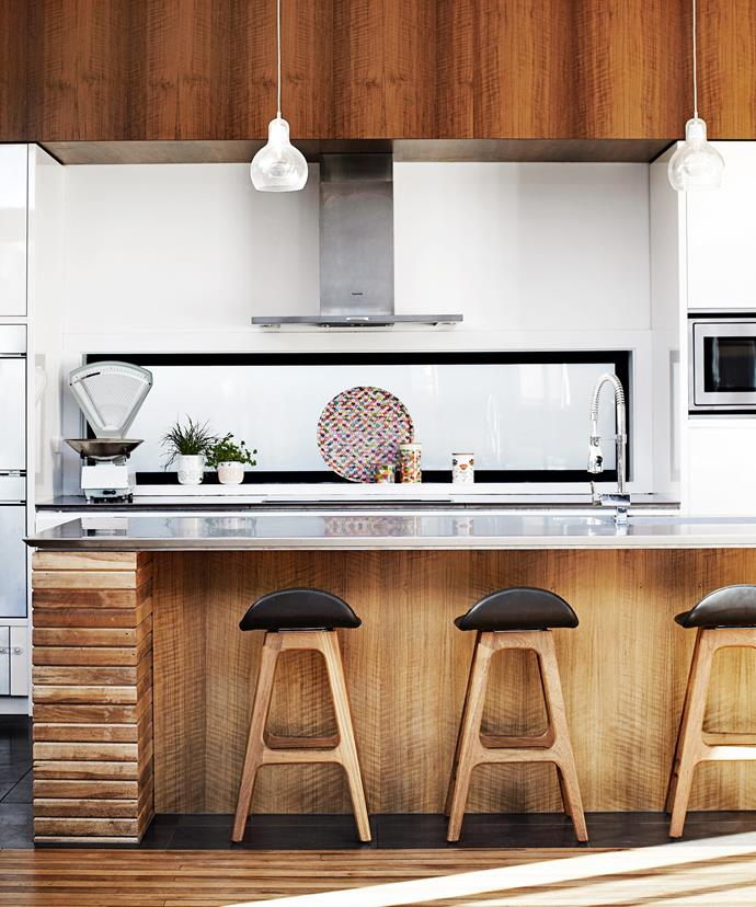 "All-white walls allow the natural beauty of the timber to come to the fore in this [60s-style Melbourne home](https://www.homestolove.com.au/gallery-virginie-and-richards-1960s-home-renovation-1544|target=""_blank""). Timber from the old walls has been used to make the kitchen island."