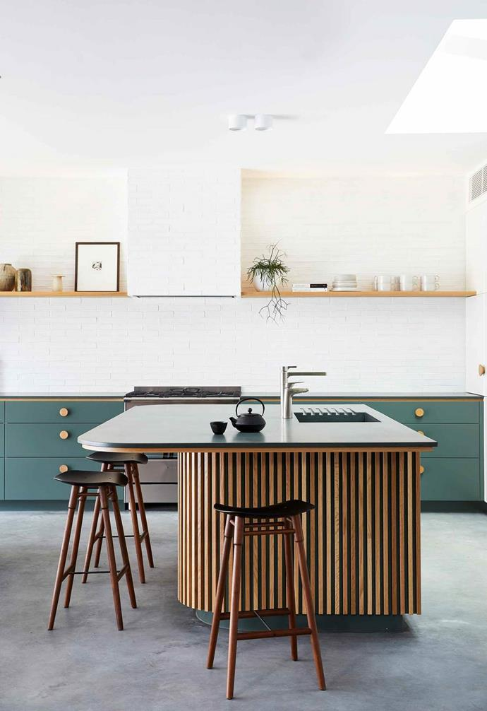 "Playing with materiality in the kitchen of her [holiday house project](https://www.homestolove.com.au/barefoot-bay-villa-byron-bay-21018|target=""_blank""), interior designer Melissa Bonney arranged for a custom dark green concrete benchtop from Concrete Nation to be the perfect finishing touch. The deep green of the concrete echoes the playful green cabinetry that lines the back wall."